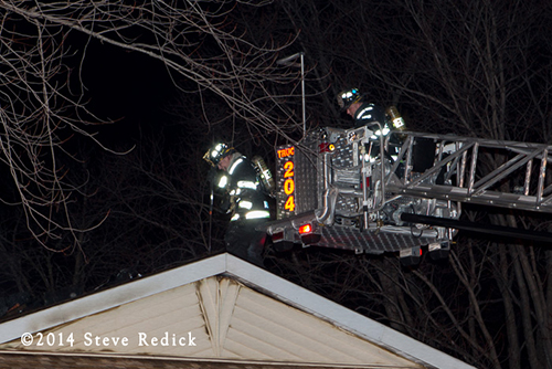 firemen on roof at night