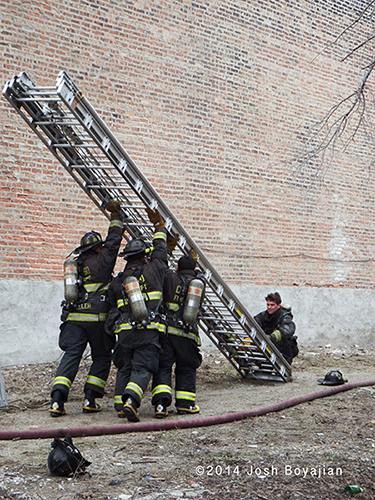 firemen raise the banger ladder