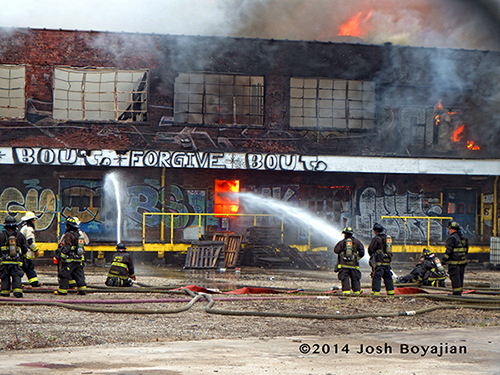 firemen battle warehouse fire