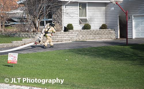 fireman pulling hose