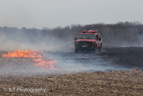 grass fire with brush truck