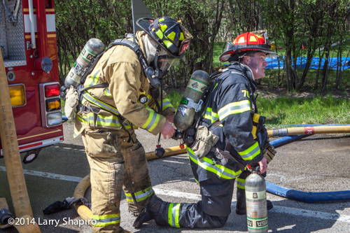 firefighter exchanges air cylinder at fire scene