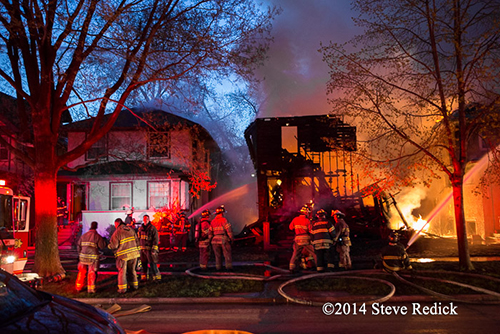 suburban residential fire scene at dawn