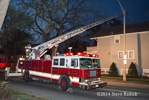 Seagrave aerial ladder truck at fire scene