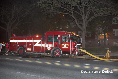 fire engine on hydrant at night