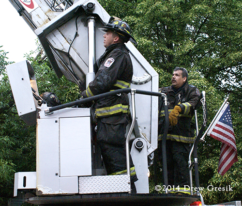 firemen with ladder truck