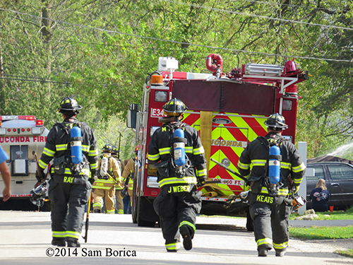 firemen at fire scene with fire trucks