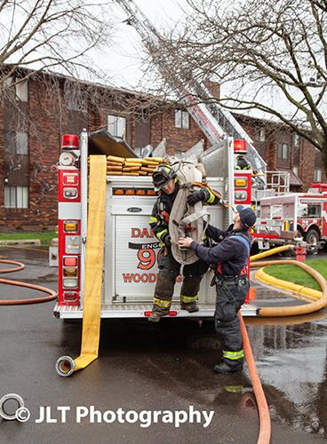 firemen pulling hose load