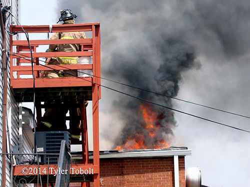flames through building roof