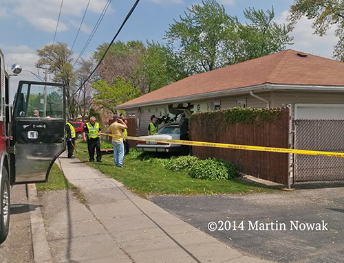 car smashes into house