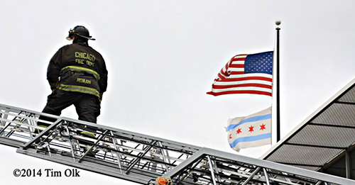 fireman on ladder with American flag