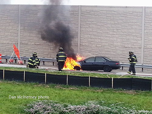 firemen extinguish car fire
