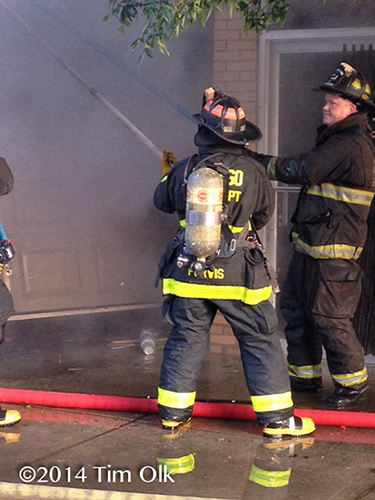 firefighters with smokey fire