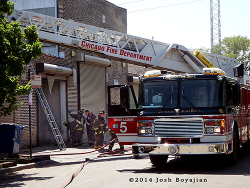 American LaFrance LTI tower ladder at fire scene