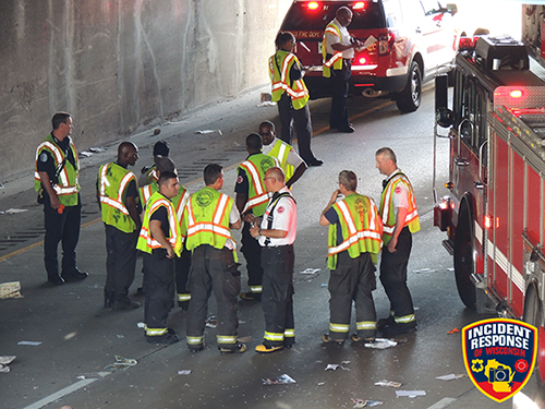 firefighters with safety vests on highway