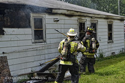 firemen overhaul after house fire