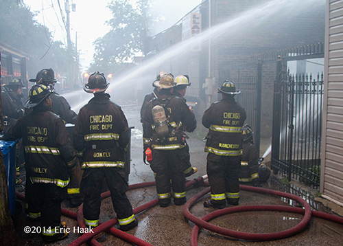 firemen at fire scene in alley