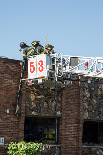 firemen in tower ladder bucket