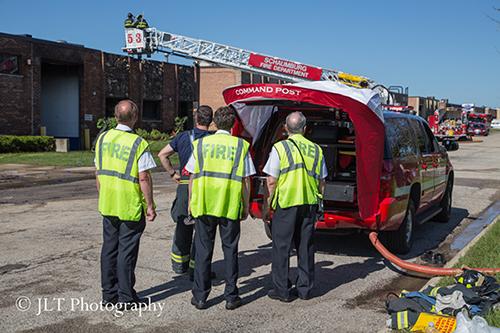 firemen at command post