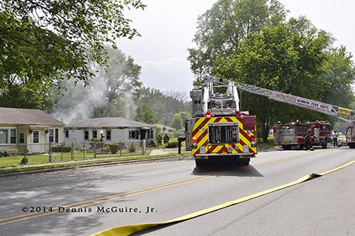 fire trucks at house fire scene