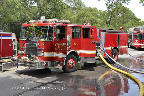 fire engine with hose off at fire sene