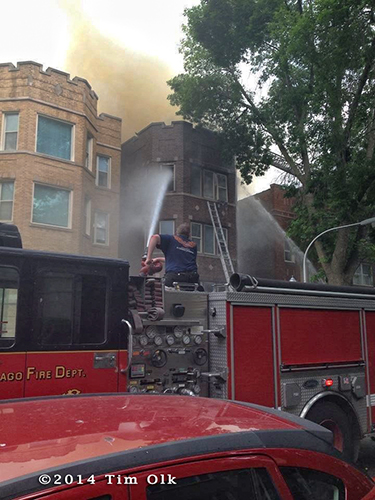 fireman uses deck gun on building fire