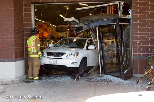 Lexus SUV backs into grocery store