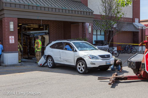 Lexus SUV after driving into a store