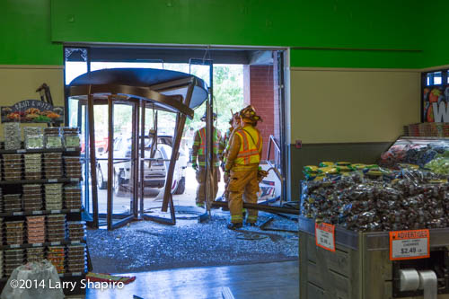 damage to store after car drives through door