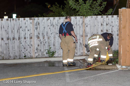 firemen connect to hydrant at night