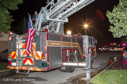 fire department ladder truck at night fire scene