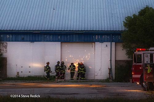 firemen cut through overhead door
