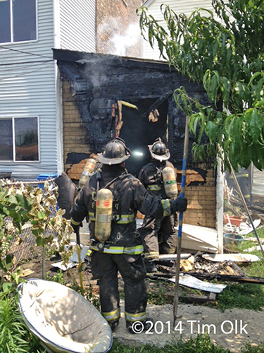firemen on the scene of a house fire