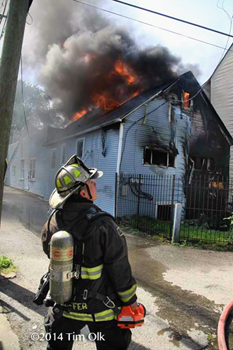 chief officer observes flames through the roof of a house