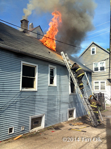 firemen leave roof after venting flames