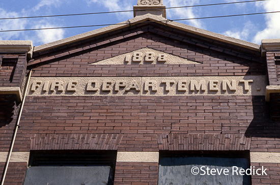 building with name misspelled in stone