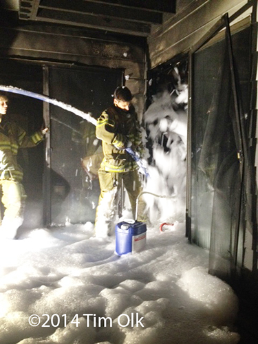 firemen apply high expansion foam