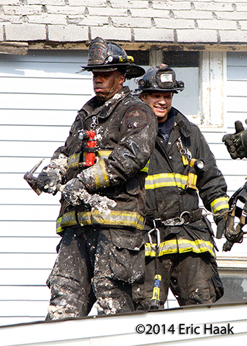 firemen after doing overhaul after house fire