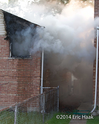 smoke conversion as water hits a house fire