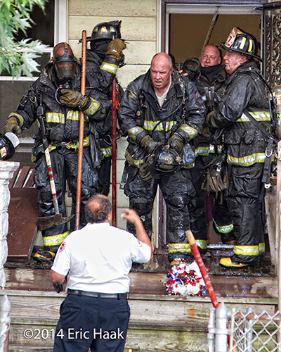 Chicago firemen after battling a house fire on a hot day