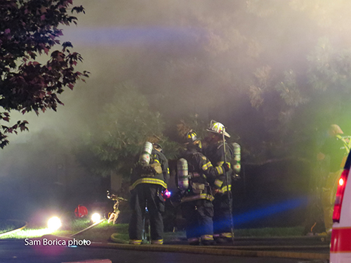 firemen at night at smokey fire scene
