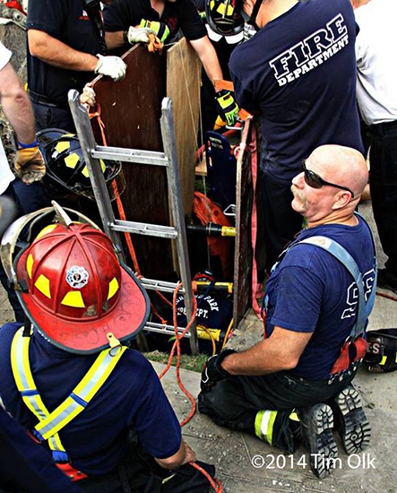 firemen rescue worker trapped in a trench