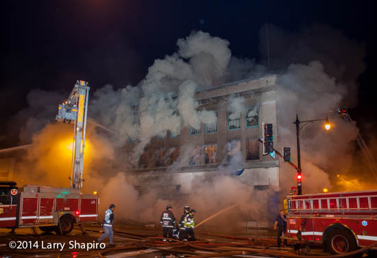 heavy smoke from commercial building at night fire scene
