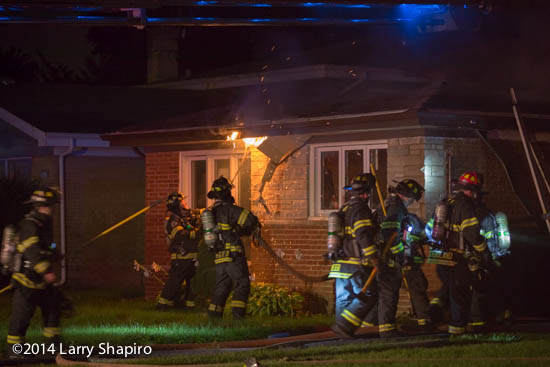 firemen overhaul soffit at hight house fire