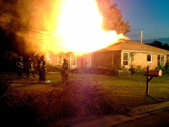 heavy fire through the roof of a house in Bridgeview 8-9-14.