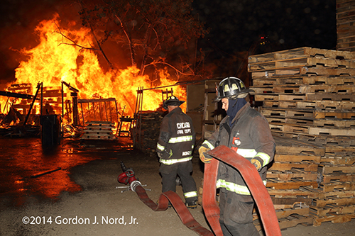 huge fire scene at night in Chicago