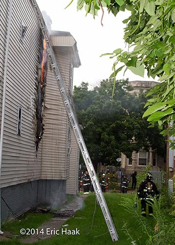 fire burns through siding on house