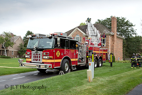 Pierce Arrow XT ladder truck at fire scene