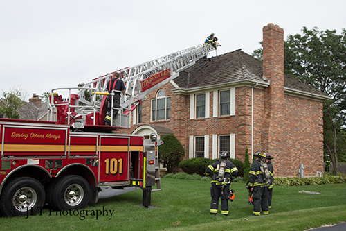 aerial ladder truck to the roof of a house