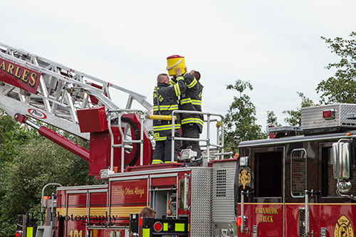 firemen hydrating after fire